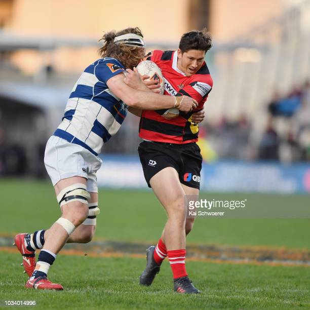Sam Beard of Canterbury is tackled by Evan Olmstead of Auckland during the round five Mitre 10 Cup match between Canterbury and Auckland at...