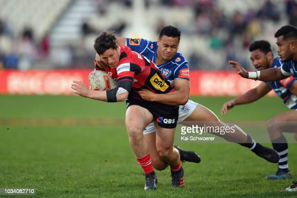 Sam Beard of Canterbury is tackled by Leon Fukofuka of Auckland during the round five Mitre 10 Cup match between Canterbury and Auckland at...