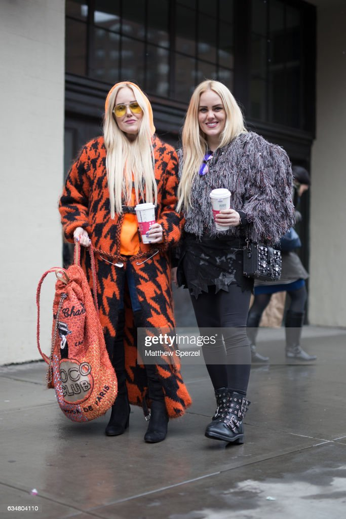 Sam Beckerman and Cailli Beckerman are seen attending Ryan Roche during New York Fashion Week wearing a black and orange coat and grey fringe coat on February 11, 2017 in New York City.