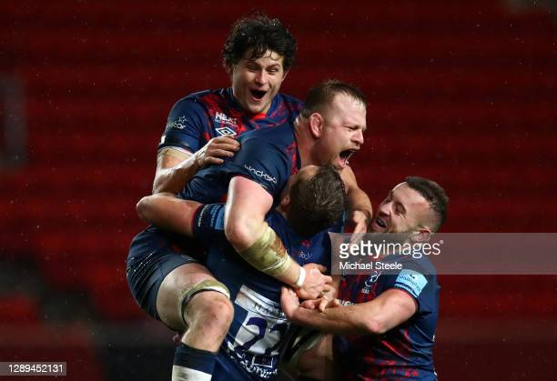 Sam Bedlow of Bristol Bears celebrates after scoring a last minute kick to win the game with team mates Piers O'Conor of Bristol Bears and Joe Joyce...