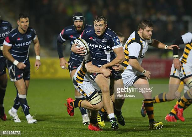 Sam Bedlow of Sale Sharks is tackled by Jack Willis of Wasps during the AngloWelsh Cup match between Sale Sharks and Wasps at AJ Bell Stadium on...