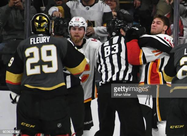 Sam Bennett of the Calgary Flames looks on as linesman Matt McPherson separates Mark Jankowski of the Flames from MarcAndre Fleury of the Vegas...