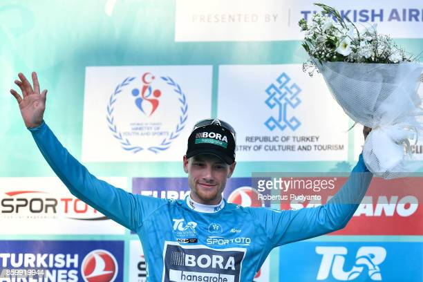 Sam Bennett of BORA Hansgrohe Germany celebrates on the podium after winning SporToto Turquoise Jersey for Overall race leader during Stage 1 of the...
