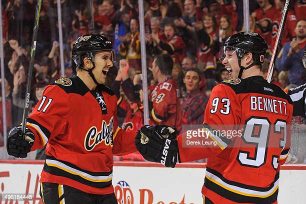 Sam Bennett of the Calgary Flames celebrates after scoring against the Pittsburgh Penguins during an NHL game at Scotiabank Saddledome on November 7...