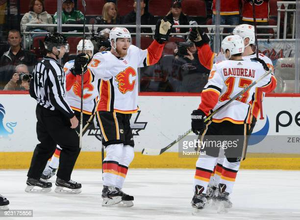 Sam Bennett of the Calgary Flames celebrates with Johnny Gaudreau and teammates after his first period goal against the Arizona Coyotes at Gila River...