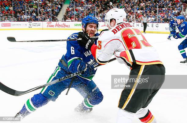 Sam Bennett of the Calgary Flames checks Yannick Weber of the Vancouver Canucks during Game Five of the Western Conference Quarterfinals during the...