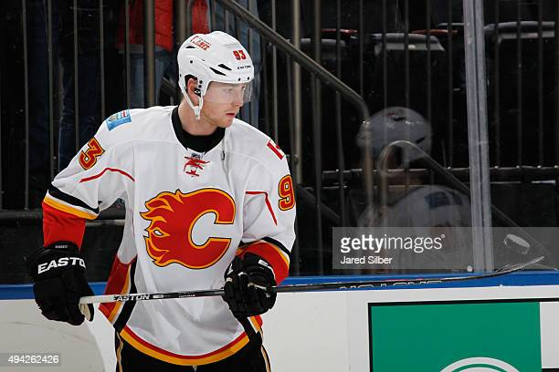 Sam Bennett of the Calgary Flames flips a puck during warm ups before the game against the New York Rangers at Madison Square Garden on October 25...