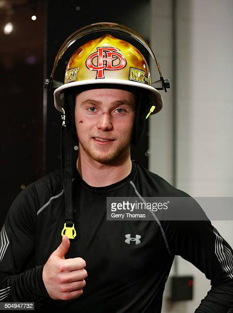 Sam Bennett of the Calgary Flames is awarded the fire helmet after his performance against the Florida Panthers at Scotiabank Saddledome on January...