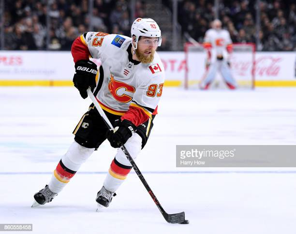 Sam Bennett of the Calgary Flames keeps skates in with the puck against the Los Angeles Kings at Staples Center on October 11 2017 in Los Angeles...
