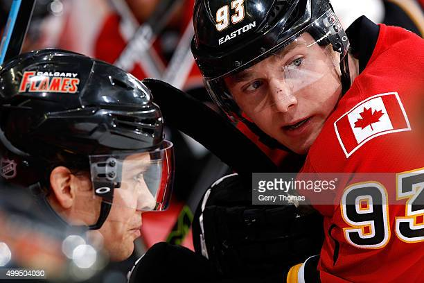 Sam Bennett of the Calgary Flames leans against the bench during a stoppage in play in an NHL game against the Dallas Stars at Scotiabank Saddledome...