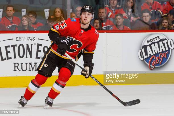 Sam Bennett of the Calgary Flames looks for a pass in an NHL game against the Minnesota Wild at the Scotiabank Saddledome on October 21 2017 in...
