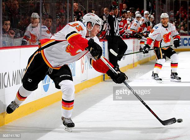 Sam Bennett of the Calgary Flames passes the puck in the third period against the New Jersey Devils on January 192016 at Prudential Center in Newark...