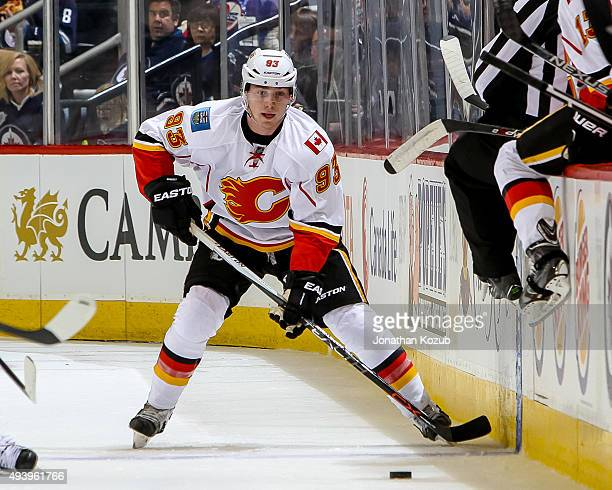 Sam Bennett of the Calgary Flames plays the puck up the ice during first period action against the Winnipeg Jets at the MTS Centre on October 16 2015...