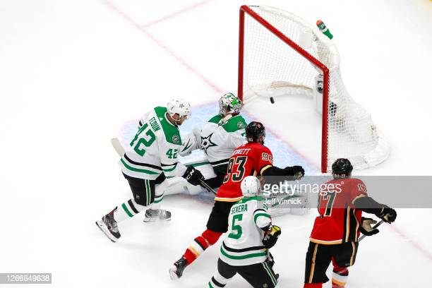Sam Bennett of the Calgary Flames scores his second goal on Anton Khudobin of the Dallas Stars during the second period in Game Four of the Western...