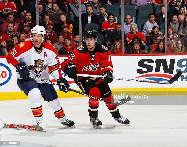 Sam Bennett of the Calgary Flames skates against Brian Campbell of the Florida Panthers at Scotiabank Saddledome on January 13 2016 in Calgary...