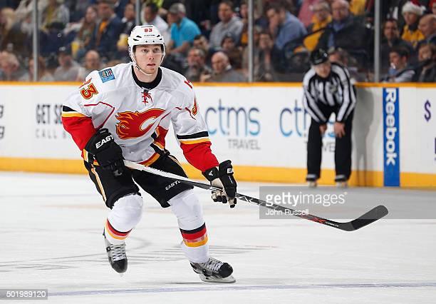 Sam Bennett of the Calgary Flames skates against the Nashville Predators during an NHL game at Bridgestone Arena on December 15 2015 in Nashville...