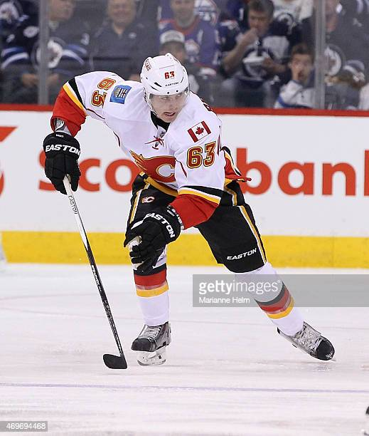 Sam Bennett of the Calgary Flames skates down the ice during second period action in an NHL game against the Winnipeg Jets at the MTS Centre on April...