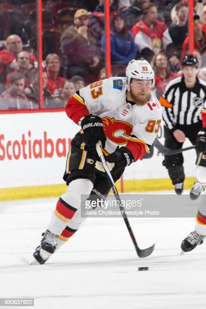 Sam Bennett of the Calgary Flames skates with the puck against the Ottawa Senators at Canadian Tire Centre on March 9 2018 in Ottawa Ontario Canada