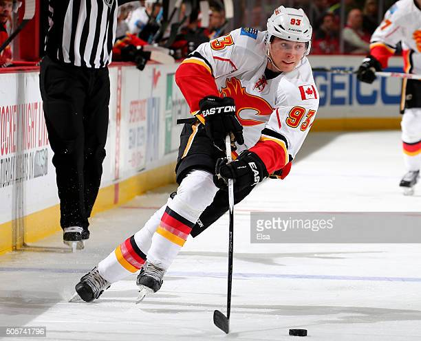 Sam Bennett of the Calgary Flames takes the puck in the third period against the New Jersey Devils on January 192016 at Prudential Center in Newark...