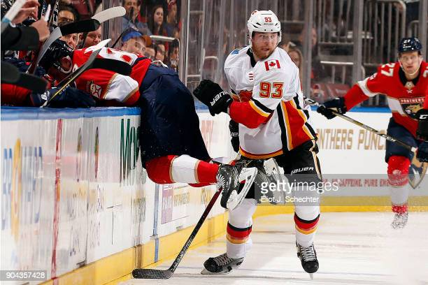 Sam Bennett of the Calgary Flames tangles with Jamie McGinn of the Florida Panthers at the BBT Center on January 12 2018 in Sunrise Florida