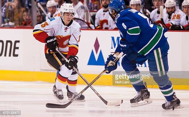 Sam Bennett of the Calgary Flames tries to get past Yannick Weber of the Vancouver Canucks in Game One of the Western Conference Quarterfinals during...