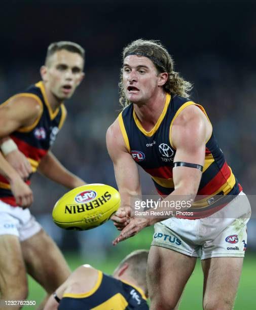 Sam Berry of the Crows handpasses the ball during the 2021 AFL Round 08 match between the Port Adelaide Power and the Adelaide Crows at Adelaide Oval...