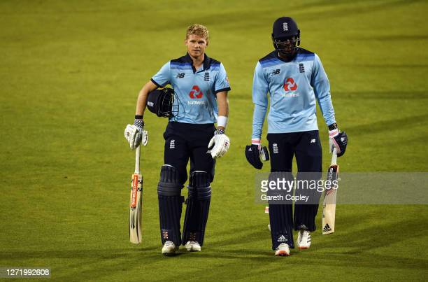 Sam Billings and Jofra Archer of England walk off after the 1st Royal London One Day International Series match between England and Australia at...