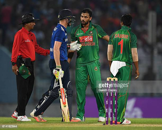 Sam Billings of England and Mashrafe Mortaza of Bangladesh exchange words after bumping into each other during the 3rd One Day International match...