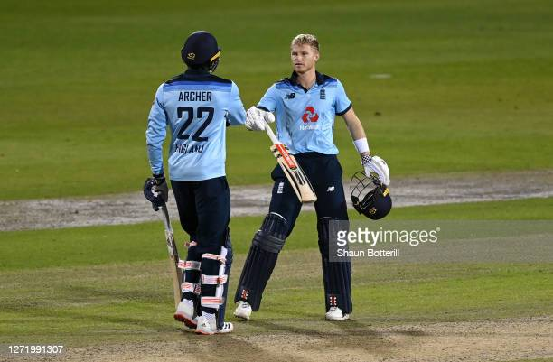Sam Billings of England celebrates reaching his century with Jofra Archer of England during the 1st Royal London One Day International Series match...
