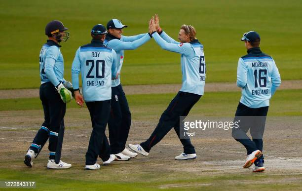 Sam Billings of England celebrates with Joe Root and teammates after running out Marnus Labuschagne of Australia during the 3rd Royal London One Day...