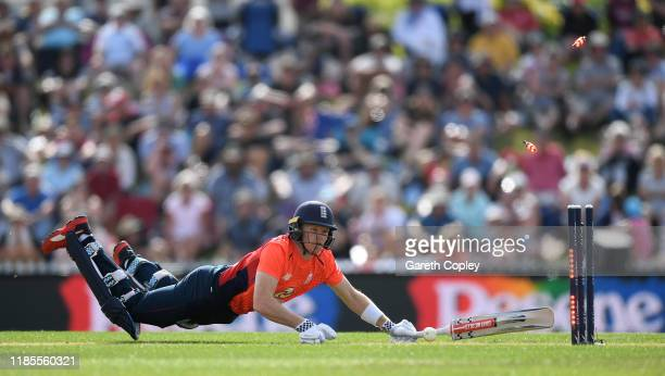 Sam Billings of England is run out Colin Munro of New Zealand during game three of the Twenty20 International series between New Zealand and England...