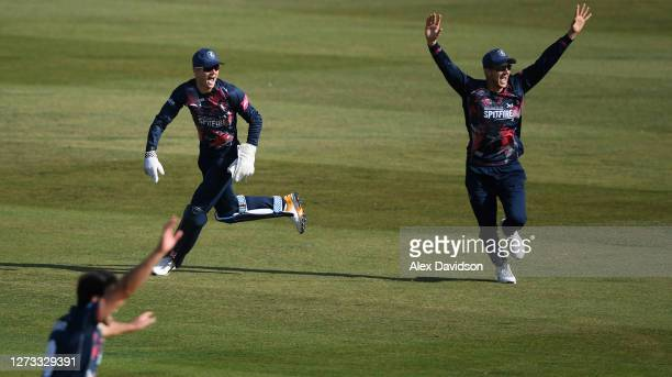 Sam Billings of Kent celebrates running out Cameron Delport of Essex with Joe Denly during the Vitality Blast game between Kent Spitfires and Essex...