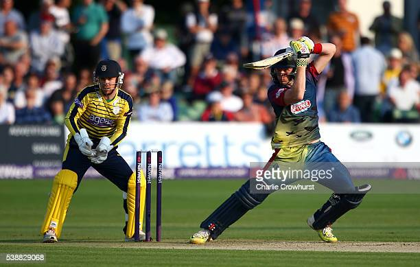 Sam Billings of Kent hits out while Hampshire wicket keeper Adam Wheater looks on during the NatWest T20 Blast match between Kent and Hampshire at...