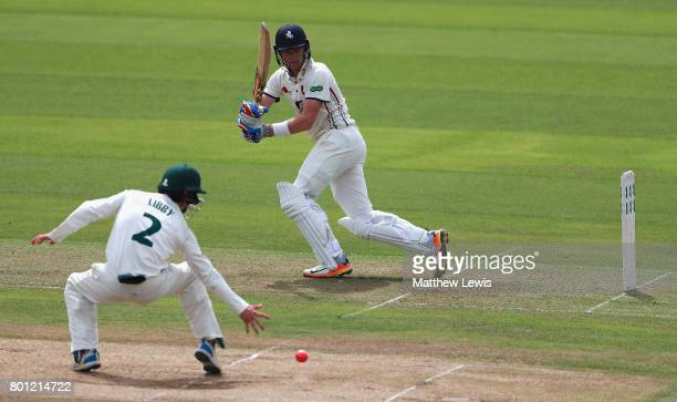 Sam Billings of Kent hits the ball past Jake Libby of Nottinghamshire during the Specsavers County Championship Division Two match between...