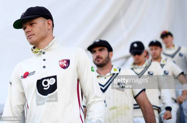 Sam Billings of Kent leads his side out during Day Two of the Specsavers County Championship Division Two match between Warwickshire and Kent at...