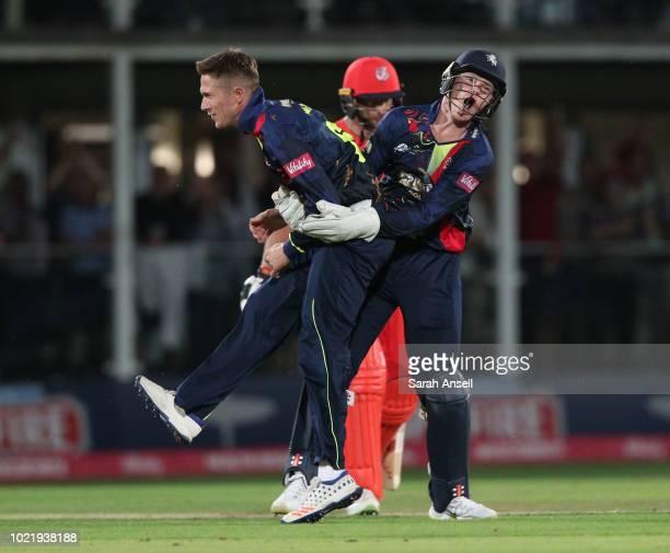 Sam Billings of Kent Spitfires celebrates with bowler Joe Denly after stumping Jos Buttler of Lancashire Lightning during the Vitality Blast...