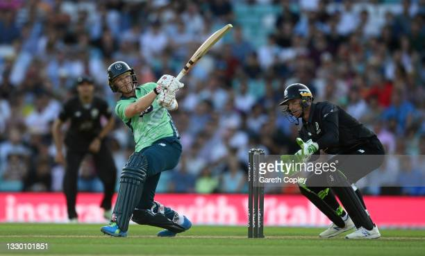 Sam Billings of Oval Invincibles bats watched by Manchester Originals wicketkeeper Jos Buttler during the Hundred match between Oval Invincibles and...