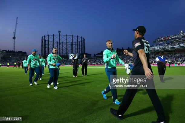 Sam Billings of the Oval Invincibles shakes hands with Jos Buttler of the Manchester Originals following The Hundred match between Oval Invincibles...