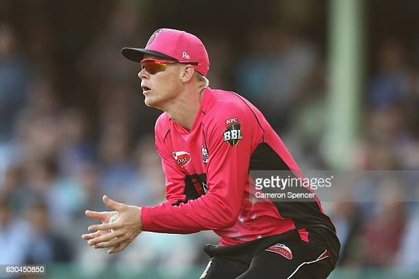 Sam Billings of the Sixers catches out George Bailey of the Hurricanes off a delivery by Johan Botha of the Sixers during the Big Bash League match...
