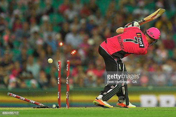 Sam Billings of the Sixers is bowled out by Shaun Tait of the Hurricanes during the Big Bash League match between the Sydney Sixers and Hobart...