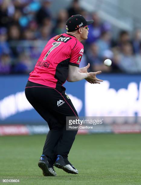 Sam Billings of the Sydney Sixers takes a catch to dismiss Matthew Wade of the Hurricanes during the Big Bash League match between the Hobart...