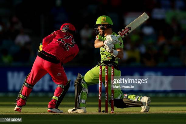 Sam Billings of the Thunder bats during the Big Bash League match between the Sydney Thunder and the Sydney Sixers at Manuka Oval, on January 13 in...