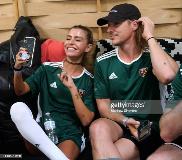 Sam Blacky and Diplo hang out between matches during the Copa Del Rave Charity Soccer Tournament at Evolve Project LA on April 17 2019 in Los Angeles...