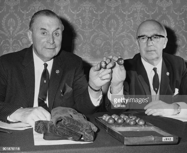 Sam Bolton chairman of the FA Challenge Cup Committee holds a number 3 ball for Everton and Dr Andrew Stephen chairman of the FA holds a number 6...