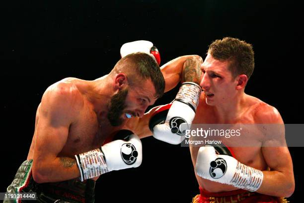 Sam Bowen punches Anthony Cacace during The British SuperFeatherweight between Sam Bowen and Anthony Cacace Arena Birmingham on November 30 2019 in...