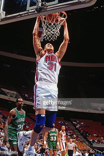 Sam Bowie of the New Jersey Nets dunks against the Dallas Mavericks circa 1991 at the Brendan Byrne Arena in East Rutherford New Jersey NOTE TO USER...