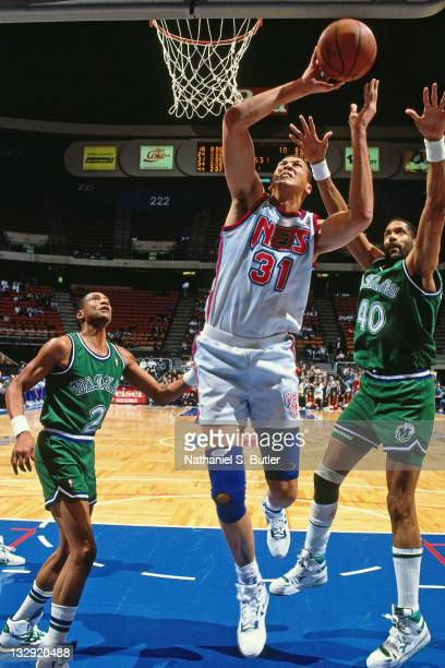 Sam Bowie of the New Jersey Nets shoots against the Dallas Mavericks circa 1991 at the Brendan Byrne Arena in East Rutherford New Jersey NOTE TO USER...