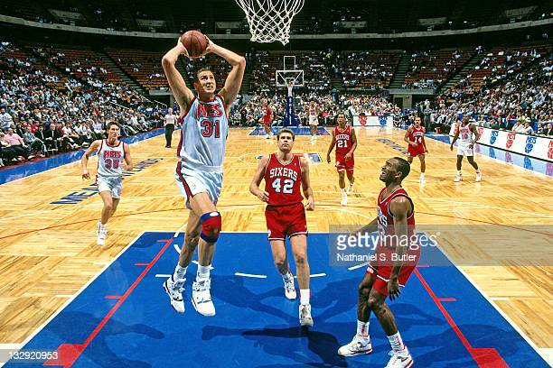 Sam Bowie of the New Jersey Nets shoots against the Philadelphia 76ers circa 1991 at the Brendan Byrne Arena in East Rutherford New Jersey NOTE TO...