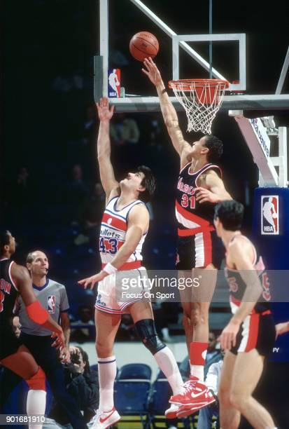 Sam Bowie of the Portland Trail Blazers attempts to block the shot of Jeff Ruland of the Washington Bullets during an NBA basketball game circa 1986...