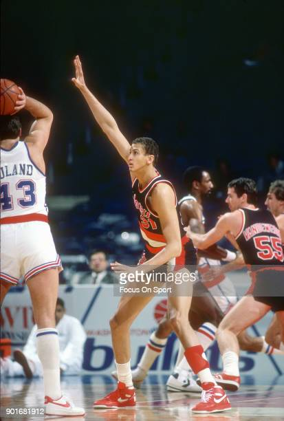 Sam Bowie of the Portland Trail Blazers closely guards Jeff Ruland of the Washington Bullets during an NBA basketball game circa 1986 at the Capital...